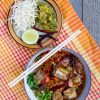 northern thai rice noodle soup with pork ribs dried cotton flowers and tomatoes - khanom jin nam ngiao
